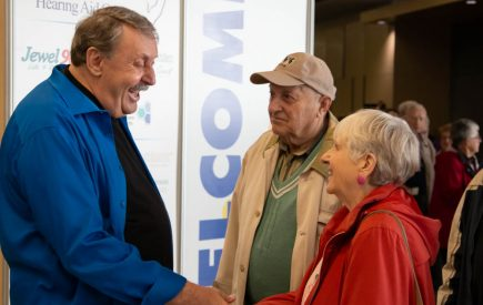 Wayne Rostad welcoming a Lifestyle Show guest.
