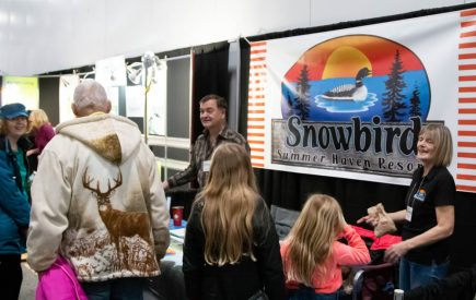 The Snowbird Haven booth showing off their properties.