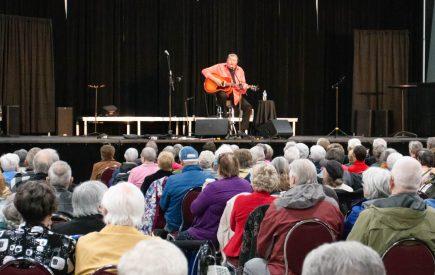 Wayne Rostad serenading a happy crowd.